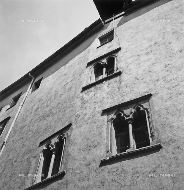 Two-light windows: detail of the faà§ade of a building in Regensburg