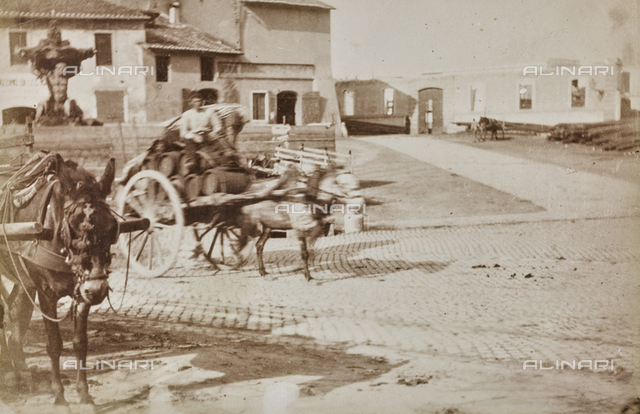 Wagons loaded with barrels of wine in the square of the Mouth of Truth in Rome