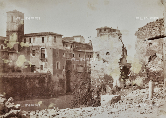Buildings demolished in the Jewish ghetto of Rome before the construction of the embankments on the Tiber. On the left of the Tiber Island