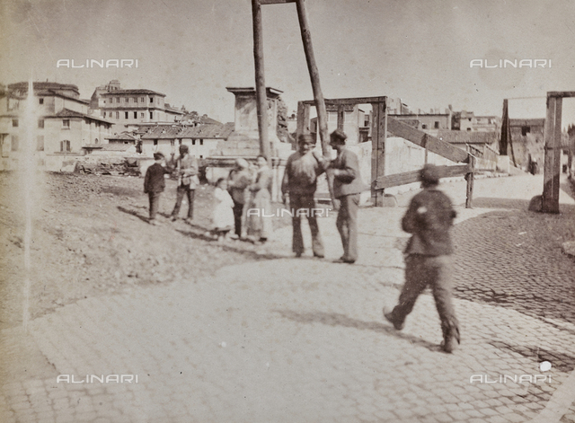 Group of people in front of Emilio Bridge (Broken Bridge) in Rome. Access to the bridge is crossed as it will be demolished to build the Ponte Palatino