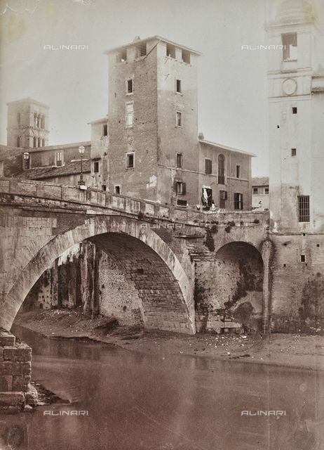 View Fabricio Bridge in Rome with Caetani tower on the Tiber Island, and, on the left, the bell tower of the church of St. Bartholomew on the Island