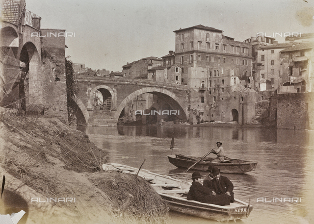 Boats on the Tiber, in the background Quattro Capi bridge (Ponte Fabricio) and the demolition of some of the buildings at Lungotevere dei Pierleoni