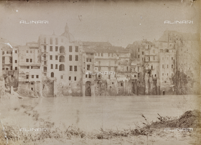 Bank of the Tiber in Tor di Nona, Rione Ponte Rome. In the background the dome of the church of San Salvatore in Lauro
