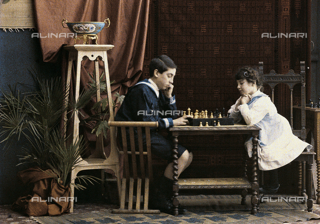 Two children playing chess