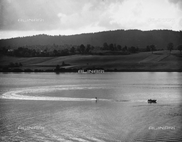 Waterskiing on a lake surrounded by hills.
