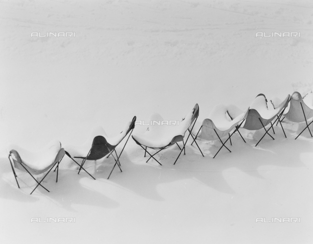 Chairs covered by snow