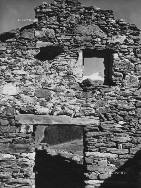 Wall of a house in the mountains in ruins