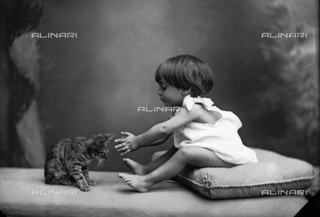 Baby girl with cat