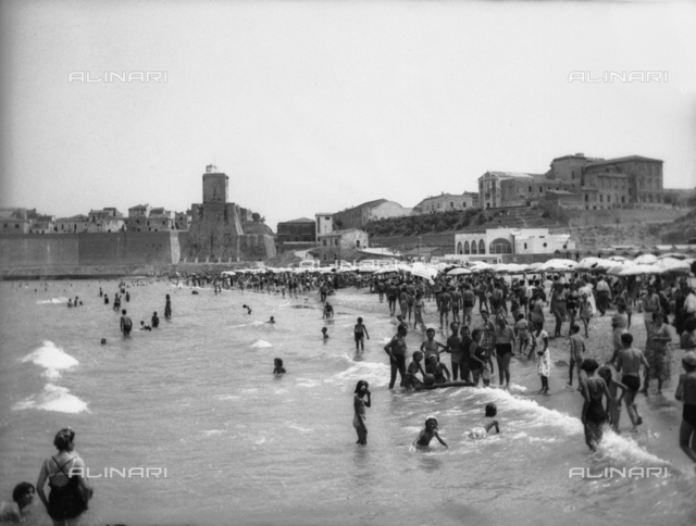 Panorama of the ancient town of Termoli from the beach crowded with sunbathers