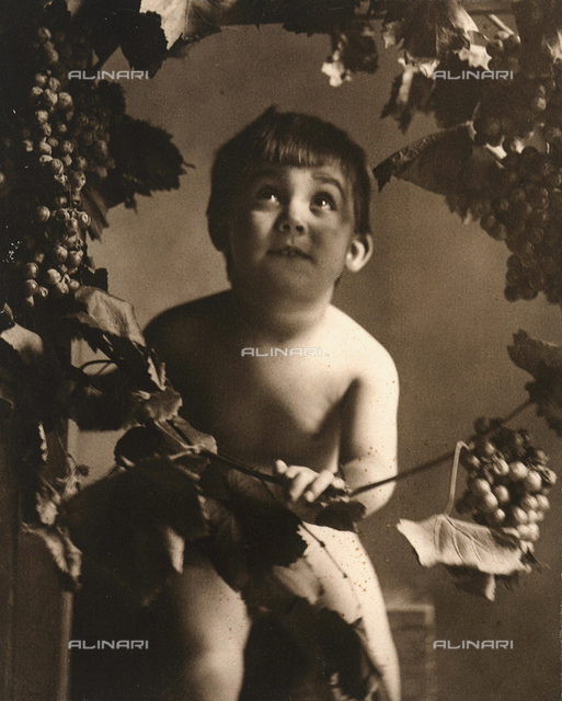 """Autumn"": Portrait of child with grapes"