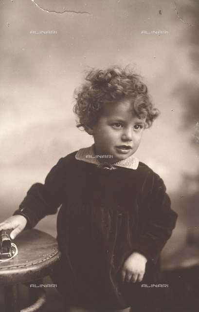 Portrait of a child with toy car