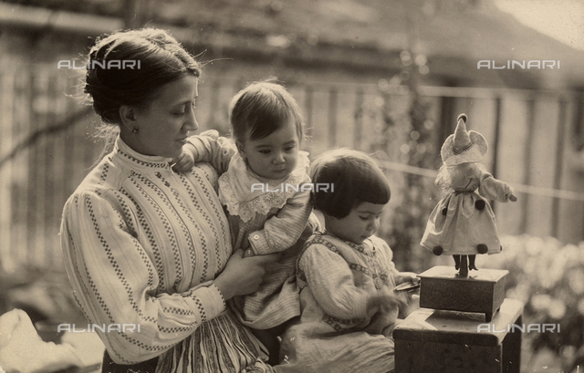 Woman with babies and doll