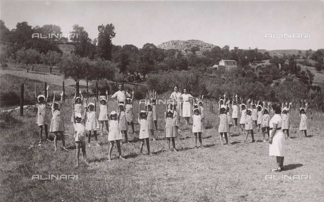 Children in a summer camp exercising