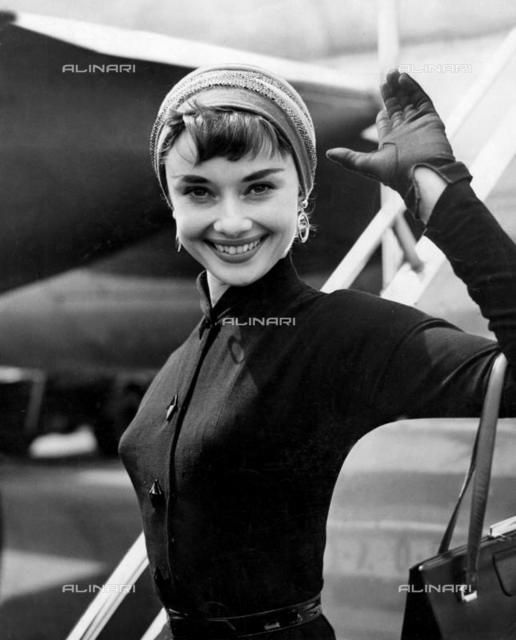 Film actress Audrey Hepburn in turban style hat arrives at London Airport from New York.21st May 1953, Personalities, Audrey Hepburn