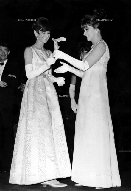 Gina Lollobrigida presents Audrey Hepburn with the Victoire du Cinema Francais award