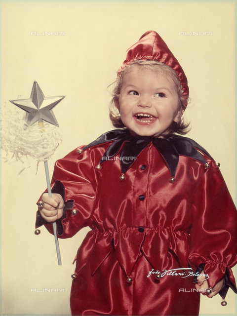 Photo of a little girl in a jester's costume
