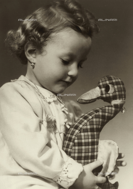 Portrait of little girl with a toy
