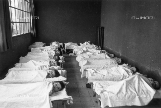Children in a hospital bed