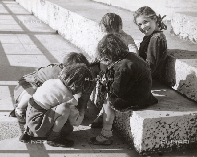 Some little girls playing in the street