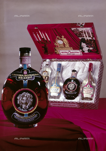Gift box of liquor bottles reserve Buton; on the box are portrayed antiques owned Buton; in the foreground a bottle of Vecchia Romagna