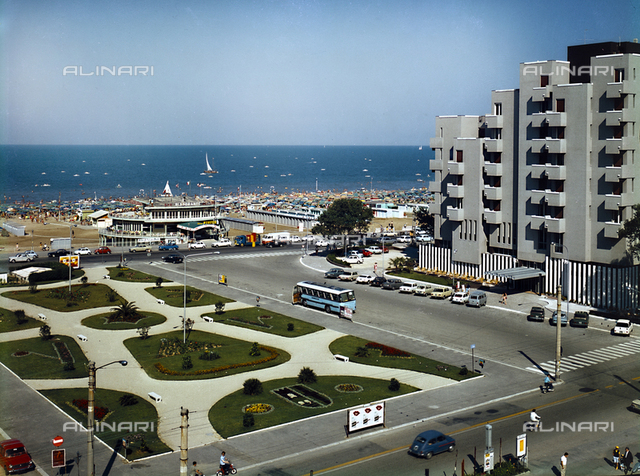 View of Piazzale Kennedy in Rimini with the Neptune Bar and Restaurant 'Hotel Bellevue, photography for the Company Living Riviera of Rimini