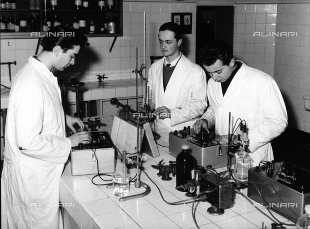 Technicians working in a chemical laboratory at the Aldini Valeriani institute.