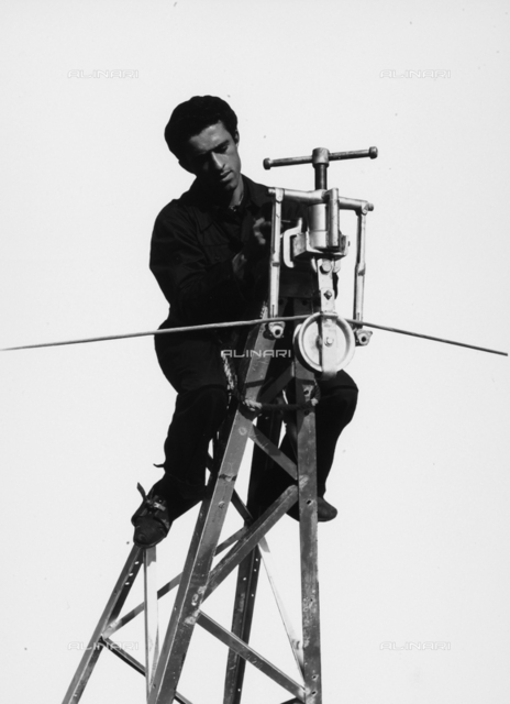 Bologna Electrical Society: worker on top of a grating.