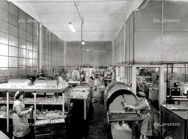 Interior of a Broggi-Izar factory. A few women workers are arranging chrome containers