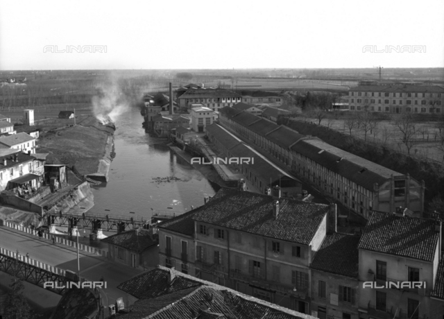 View from above of a factory on the Lambro river