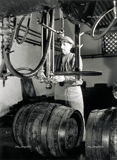 A worker in front of some isobarometric equipment inside a brewery