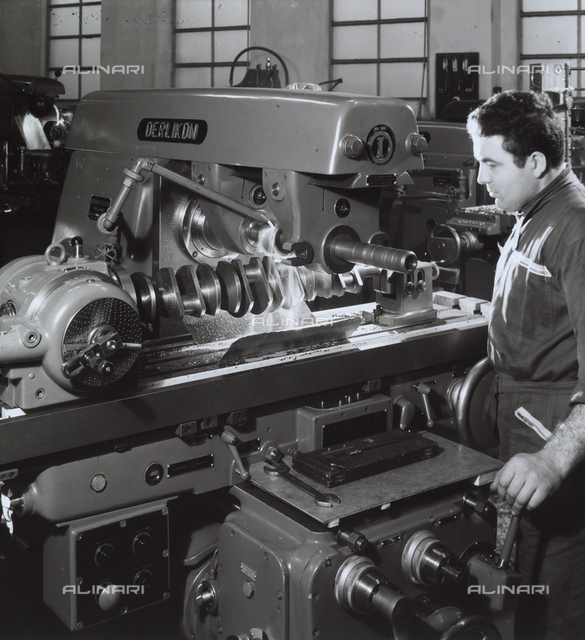 A worker operating a machine at the Ferrari factory.