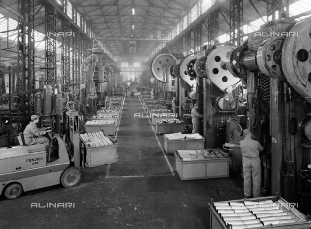 Workers at the work in the Industry of the Italian Metallurgic Society (S.M.I of the Orlando Group) of Fornaci di Barga, Lucca