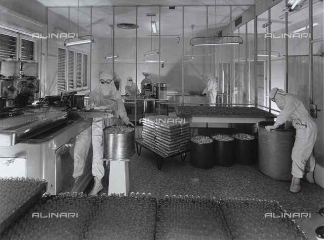 Workers in the process of sterilization at the Alfa pharmaceutical factory.