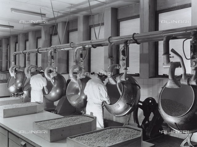 Workers operating machinery at the Recordati pharmaceutical factory.
