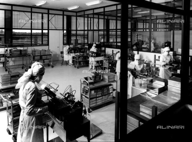 Technicians working in a pharmaceutical laboratory in the GLAXO factory.