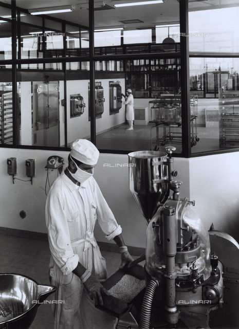 Two workers producing chemical/pharmaceutical material in the GLAXO factory.