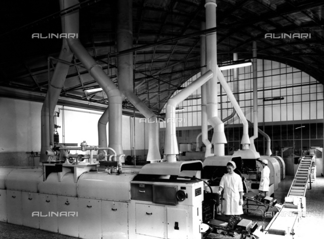 Workers at the machinery of the Lazzaroni di Saranno cookie factory.