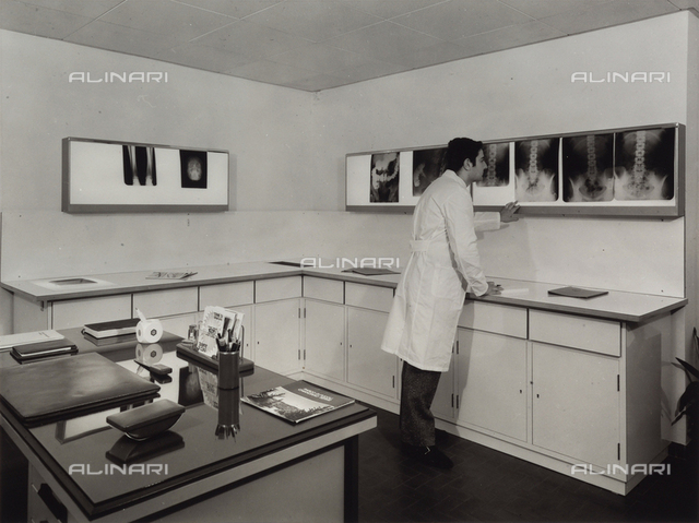 Center of Laboratory Analysis at Chianciano Spa. Radiology room with a young doctor analyzing a screen with some x-rays.