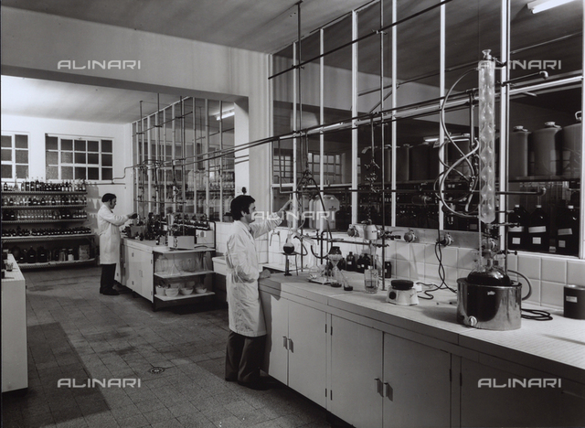 Technicians working in the laboratory of the NAARDEN LEEPEN factory, producers of the bases of perfumes and cosmetics.