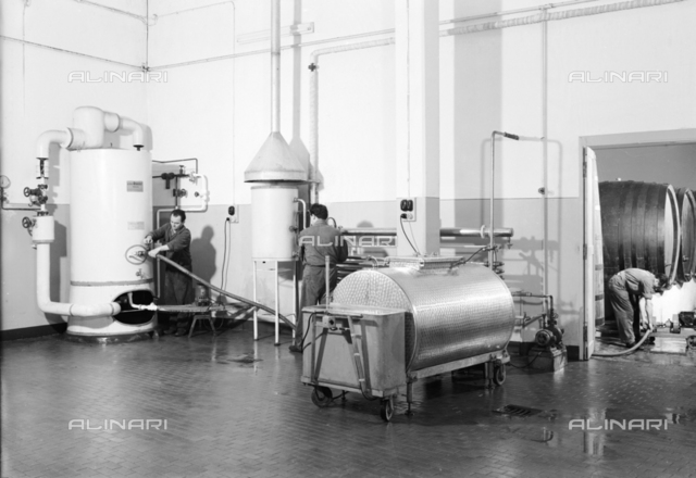 Interior of a Distillery Fabbri plant with workers to work, Bologna