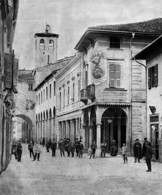 Ancient view of Imola with clock and arcades: photographic reproduction of 1963