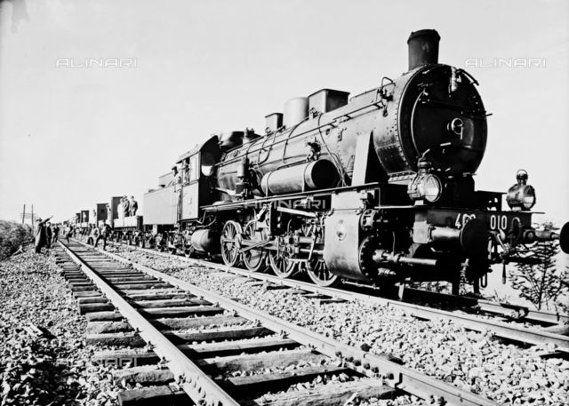 Means of transport old and new: view of locomotive on binaries; photographic repoduction of the sixties