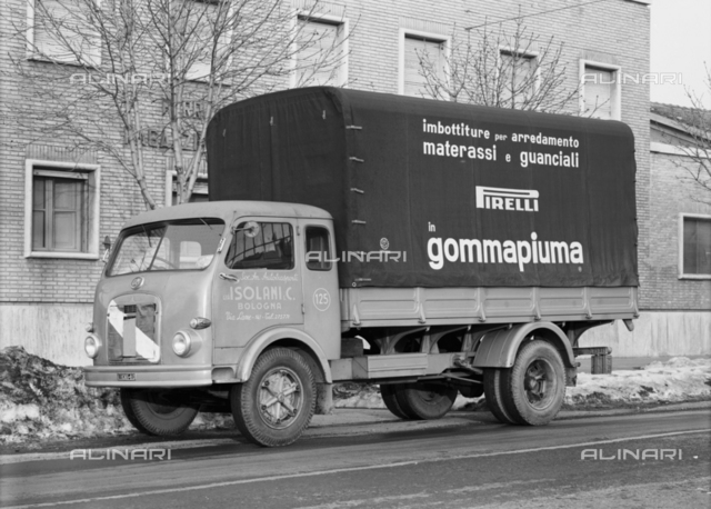 Means of transport old and new: view of Camion of Isolani Trucking Company, Bologna