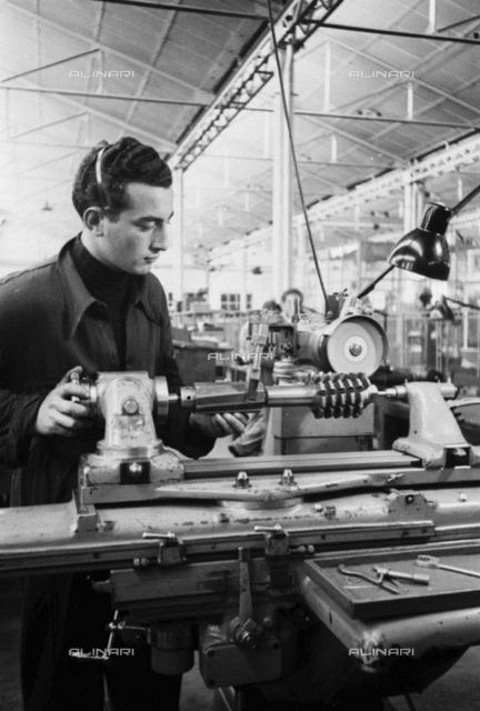 A worker at work inside the Innocenti automobile factory