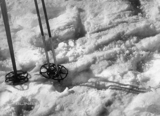 """The White Sport"". Ski poles in the snow"