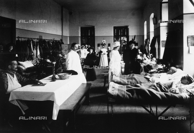 Decorated salon at a hospital with war wounded, doctors, Red Cross nurses and visitors