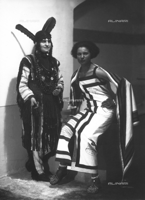 Portrait of Marion Wulz in a Suaheli di Zanzibar carnival costume in the company of a friend wearing an Indian costume