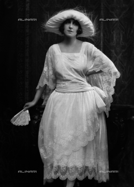 Portrait of a woman with hat and fan