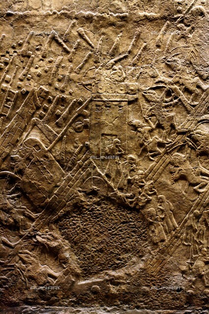 Wall panel depicting the assault on Lachish. Assyrian, approximately 700-692 BC. From the South-West Palace in Nineveh. Shows men and women streaming out of the town into exile.