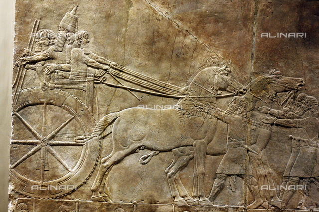 Wall panel depicting the royal lion hunt. Grooms lead horses towards an enclosure. Assyrian, circa 645-635 BC. From the North Palace in Nineveh.